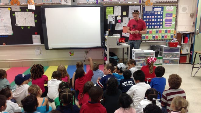 Sam Riehl discusses what it is like to work as a blacksmith during Ridge Elementary's Career Day last week.