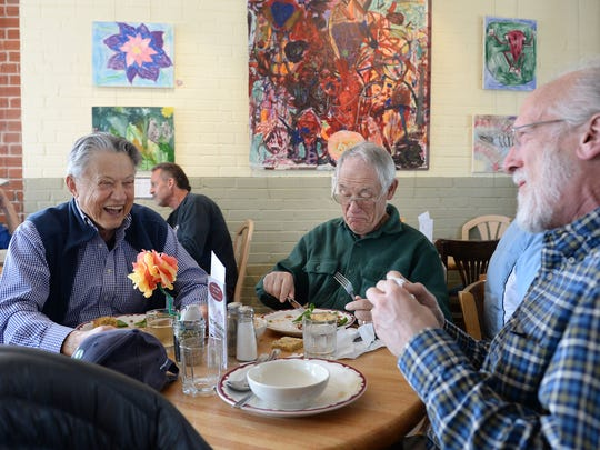 Bob Molison, from left, Pieter Aukema and Brian Woodruff enjoy each other's company at FoCo Cafe on Tuesday, April 19, 2016. The nonprofit restaurant runs on volunteer labor and serves meals on a donation basis.