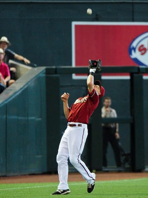 May 24, 2015: Arizona Diamondbacks shortstop Nick Ahmed (13) catches a fly ball during the first inning against the Chicago Cubs at Chase Field.