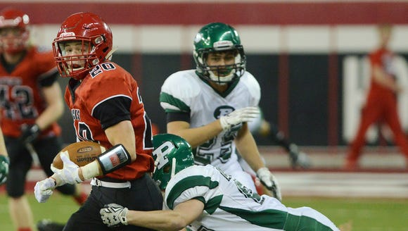 Yankton's Tanner Frick carries the ball as Pierre's