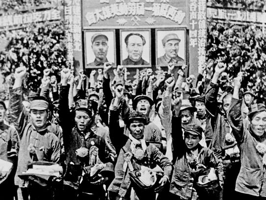 Residents of Beijing welcome the Chinese Communist forces of Mao Zedong in 1949.