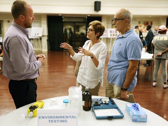 Carolyn Egana and husband John speak with Scott McManus