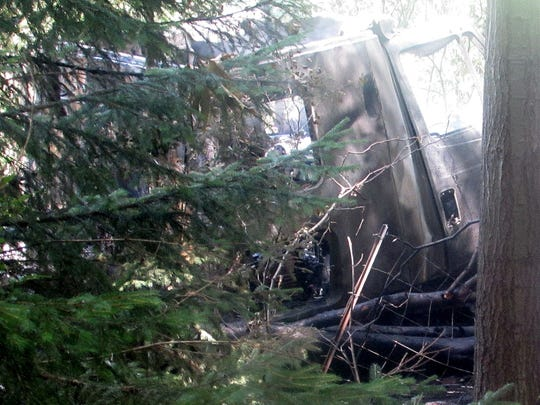The burned out cab of a tractor trailer sits on the edge of the woods off I-86 in the Town of Elmira.