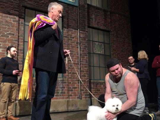 "Westminster dog show winner Flynn the bichon frise poses with handler Bill McFadden foreground left, and actor Daniel Stewart Sherman, before doing a walk-on part at the Broadway musical ""Kinky Boots"" in New York, Wednesday, Feb. 14, 2018."