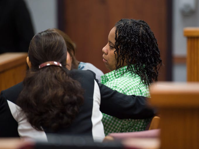 Lanadieal Ashe (center) speaks with defense lawyers
