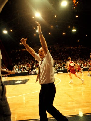 Coach George Griffith celebrates the Richmond Red Devils 1992 state basketball championship