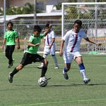 Don Bosco's Fred Aragones, from the Philippines, sends the ball forward against the ASC Trust Islanders in an opening day U14 division match of the Youth Invitational Gobblefest soccer tournament at the Guam Football Association National Training Center Friday. The Islanders won 5-1.