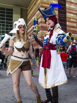 The Phoenix Comicon got underway Thursday, May 25, 2017, at the Phoenix Convention Center.  Cosplay participants Liz Coon, 24, dressed as Cubone, left, and Jessica Carter, 24, dressed as Miss Fortune ,pose between buildings at the center.
