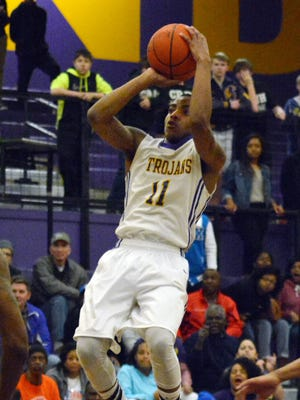 Alexandia Senior High's J.D. Williams shoots against Southwood on Friday. The 14th-seeded Trojans defeated Southwood, 56-44.