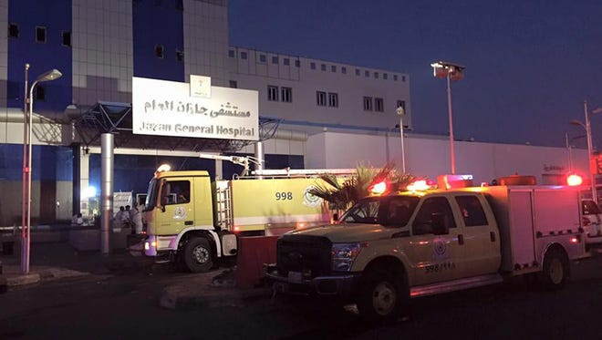 A handout picture made available by Saudi Arabia's Directorate of Civil Defense shows emergency service vehicles at the scene of a fire at the Jazan General Hospital in Jazan, Saudi Arabia,  Dec. 24 2015