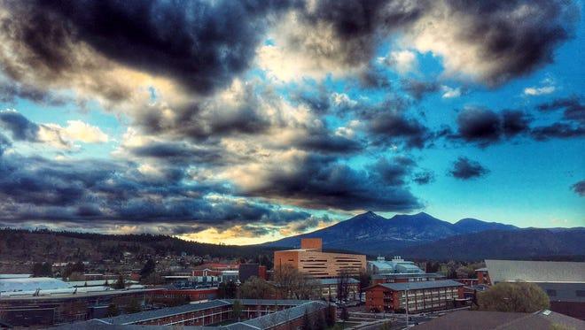 """After a long day at Northern Arizona University, Austin Young of Flagstaff found a moment of peace around sunset. He writes: """"I noticed how beautiful the skies were as the sun set on the clouds and the San Francisco peaks."""" He shot this photo from the San Francisco parking garage on campus. See more of his photos at instagram.com/younggrasshoppuh."""
