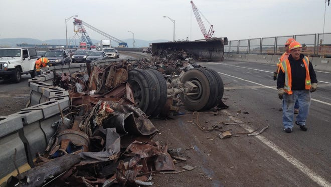 A dump truck rolled over and spilled debris on the Tappan Zee Bridge on Friday, May 13, 2016.