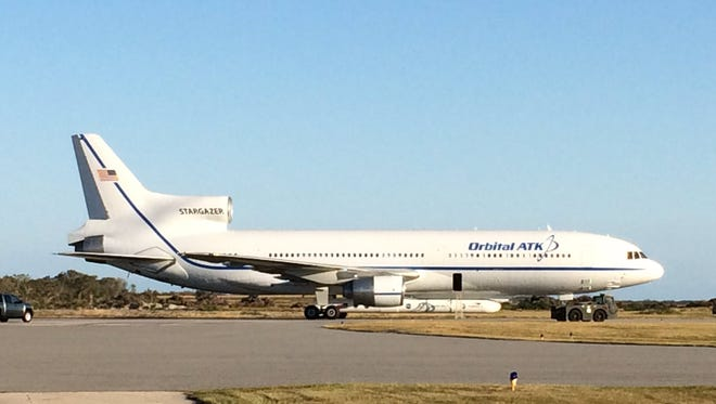 Orbital ATK's Stargazer L-1011 carrier aircraft, carrying a Pegasus XL rocket with eight NASA science satellites.