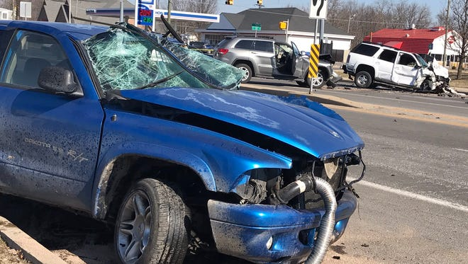 A suspect in white SUV led police on a chase through Lawrence Police Department, Indianapolis Metropolitan Police Department and Indiana State Police jurisdiction before crashing here at the intersection of 10th Street and Post Road.