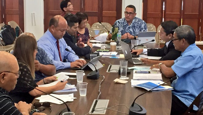 Education officials led by Superintendent Jon Fernandez discuss with senators accountability in funds raised by public school students, parents and teachers Thursday morning at the Guam Congress Building.
