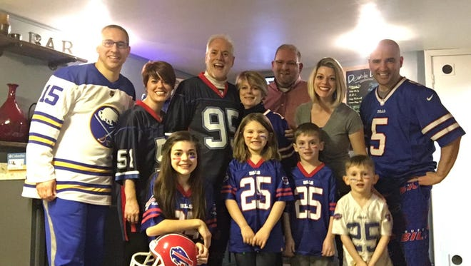 Dick DeGroat, center, with his wife Denise (on his right), and their immediate family at their Irondequoit home.