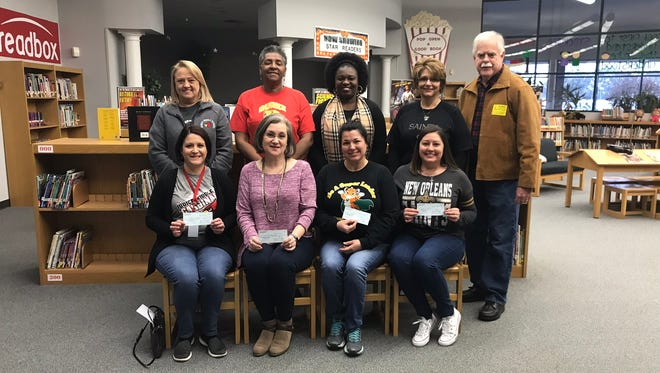 The Knights of Columbus St. Basil Council recently made a donation to four Lafayette Parish school libraries.