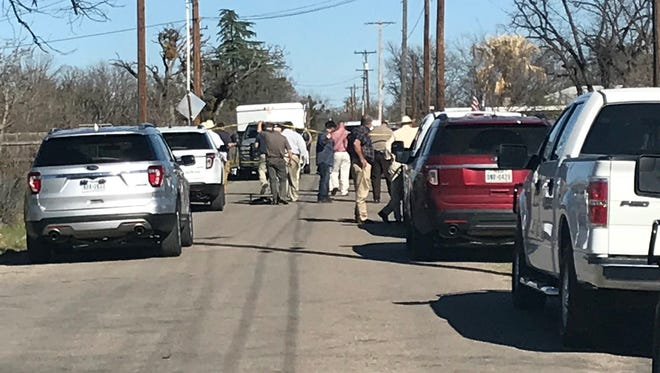 Law enforcement officials investigate in the 1000 block of Cactus Lane in north San Angelo after a body was found in a dumpster Tuesday, March 20, 2018.