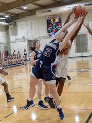 Ava Prudhomme fights for the rebound as Northside host STM basketball in Lafayette, La., Friday, Jan. 13, 2017.