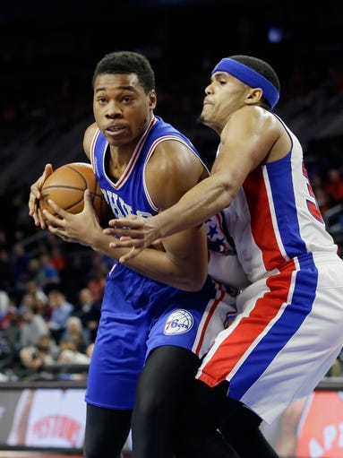 Philadelphia 76ers forward Richaun Holmes, left, runs