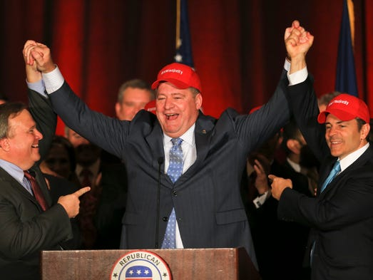 House Republican leader Jeff Hoover, center, celebrates