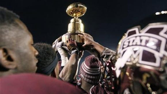 Mississippi State celebrates its Egg Bowl win against Ole Miss in the 2013 matchup.