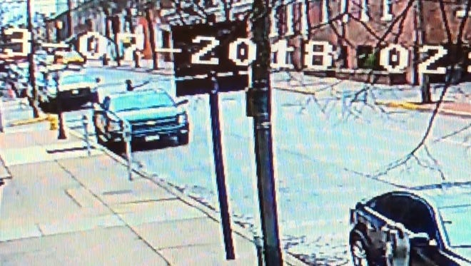 Two shooters were caught on a surveillance camera firing down Clark Avenue from Duke Street in York on Wednesday.