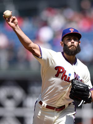 Jake Arrieta throws a pitch during the first inning Sunday.