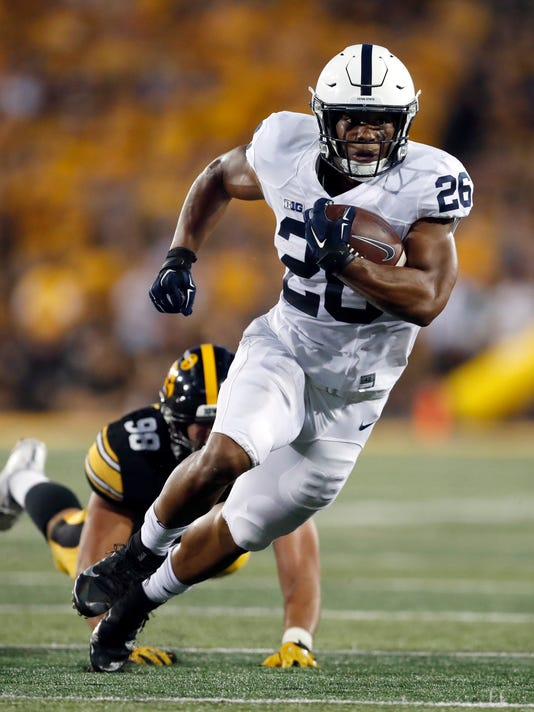 FILE - In this Sept. 23, 2017, file photo, Penn State running back Saquon Barkley carries during the first half of an NCAA college football game against Iowa in Iowa City, Iowa. Barkley leads the nation in all-purpose yards (253.3) after setting a school record with 358 yards in last week's win at Iowa. (AP Photo/Jeff Roberson, File)
