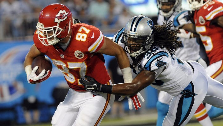Kansas City Chiefs tightend Travis Kelce (87) runs the ball as he is pursued by Carolina Panthers safety Robert Lester (38) during the second half of the game at Bank of America Stadium.