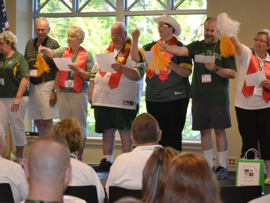 A cheer squad gets fellow attendees in the spirit during a kickoff homecoming assembly for the National Marriage Encounter summer conference Thursday night, July 10, at St. Norbert College in De Pere.