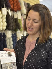 Kelly Otty, a co-owner of Must Love Yarn, shows off