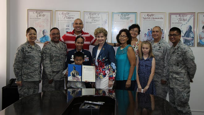 GUANG Master Sgt. Maria Quitugua was named Senior Noncommissioned Officer (SNCO) of the Year for 2015 Air National Guard Outstanding Airmen of the Year. Congresswoman Madeleine Z. Bordallo is pictured presenting Master Sgt. Maria Quitugua with the Congressional Extension of Remarks recognizing her for her accomplishments. L-R: Maj. Veronica Reyes, GUANG Comptroller; Chief Master Sgt. Gerard Damian, GUANG Command Chief; Senior Master Sgt. Michael Quitugua, spouse; Master Sgt. Maria Quitugua; Michael Quitugua Jr.; Congresswoman Bordallo; Mrs. Laling Quitugua; Ms. Frances Bradley; Angelina Bradley; Lt. Col Tim Puzan, GUANG HRO; and Maj. Christian Cruz, 254SFS Commander.
