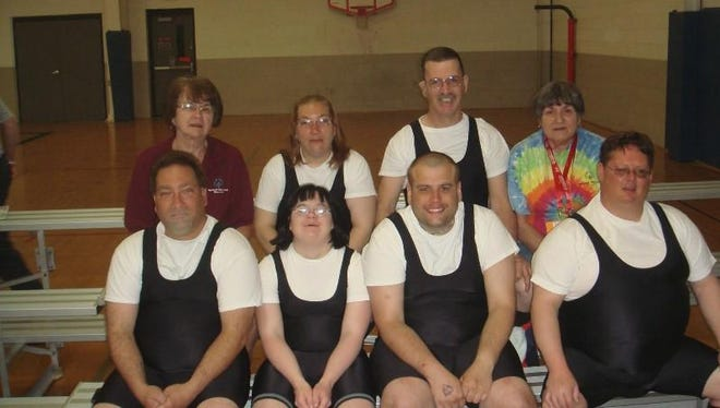 Manitowoc County Miracles Powerlifters competed at Special Olympics Summer State Games in Stevens Point June 6. Pictured — top row, L-R: Karen Schuh,Lori Mason, Scott Wells, Pat Neuenfeldt; bottom row: Mike Mason, Sara Schuh, Greg Leslie, Dan Neuenfeldt.