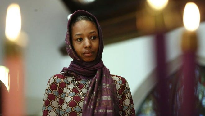 Larycia Hawkins, a Christian, wears a hijab at church. The Wheaton College political science professor is facing termination for a Facebook post stating that Christians and Muslims worship the same god.
