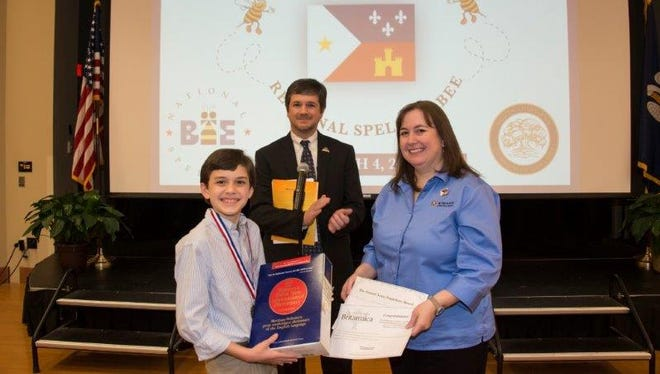 Michael Goss of Crowley will participate in the 2016 Scripps National Spelling Bee. Also pictured are Kiwanis Club bee co-chairs David Edmond and Kim Champagne.