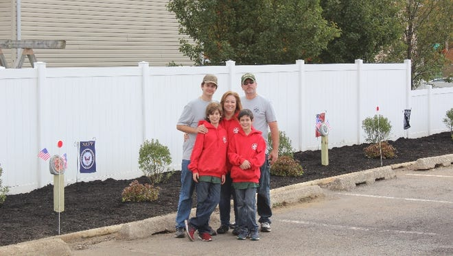 The Fleissner Family in front of the finished Eagle Scout Project at Cliffwood VFW Post 4745.