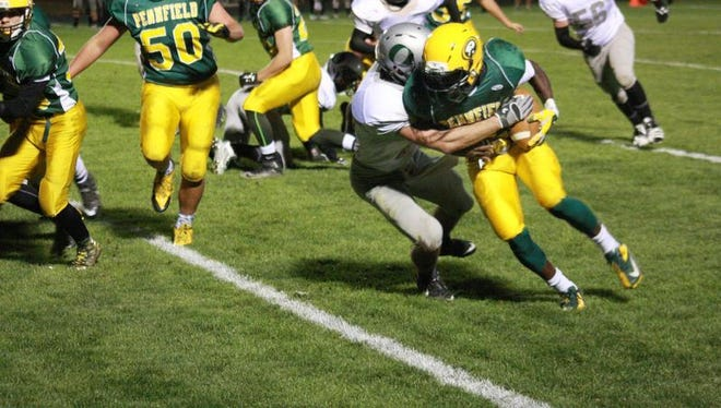 Olivet, shown in last year's game against traditional rival Battle Creek Pennfield, is aiming for its ninth straight trip to the state playoffs and 13th in the past 14 years.