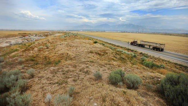 A Friday, Aug. 5, 2016 photo shows land in West Jordan, Utah, that may be purchased by Facebook for a data center. The race between the small town of Los Lunas in New Mexico and the Salt Lake City suburb of West Jordan to entice a new Facebook data center with millions in tax breaks and subsidies is raising questions about public investments in a booming cloud-computing economy that typically brings few local jobs.