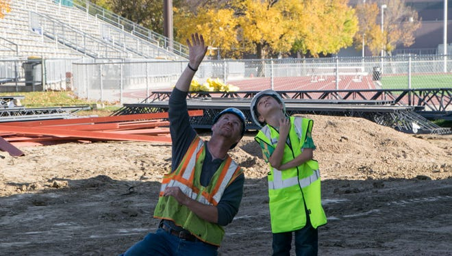 Brian Tull explains construction equipment to 8-year-old Rylan Philips, who says he wants to be a crane operator when he grows up.