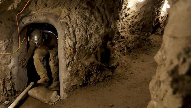 """In this March 6, 2017 photo, a member of the Border Patrol's Border Tunnel Entry Team enters a tunnel spanning the border between San Diego and Tijuana, Mexico, in San Diego. They are known in the Border Patrol as """"tunnel rats"""" - agents who go in clandestine passages that have proliferated on the U.S.-Mexico border over the last 20 years to smuggle drugs."""