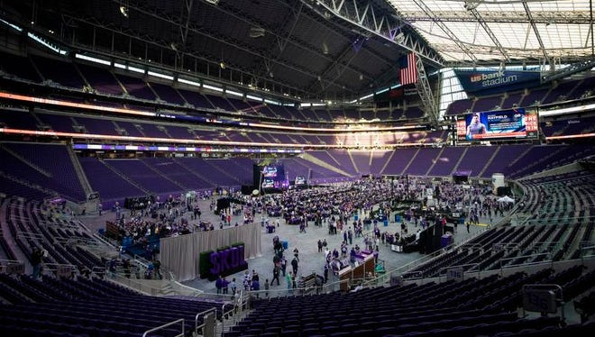 Fans attend the Minnesota Vikings' NFL football draft party Thursday, April 26, 2018, at U.S. Bank Stadium in Minneapolis.