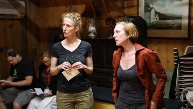 """Cassandra Bissell and Maggie Kettering, from left, respectively play Holmes and Dr. Watson in the Christopher Walsh mystery """"Miss Holmes,"""" on stage from July 4 to 22 at Peninsula Players Theatre."""