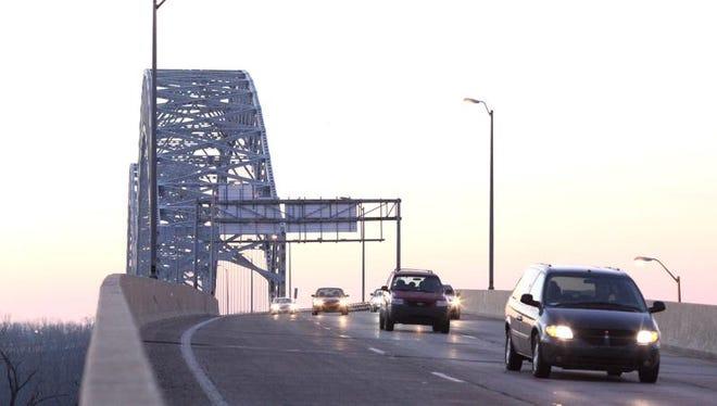 Commuters drive across the Sherman Minton Bridge.