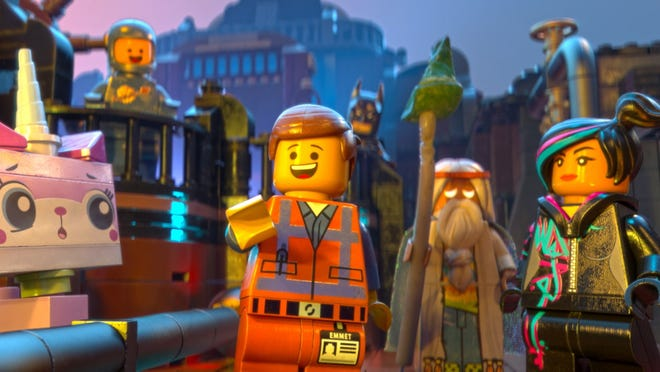 Emmet (Chris Pratt), Batman (Will Arnett), Vitruvius (Morgan Freeman) and Wyldstyle (Elizabeth Banks) enter a world of playful construction in the new 3D animated feature 'The LEGO Movie.'