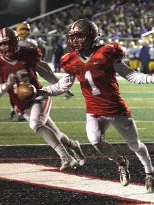 Shelby's Brady Hill celebrates scoring a touchdown Friday night.