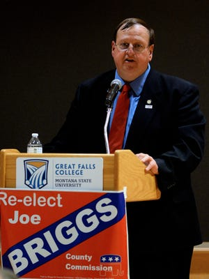 Commissioner Joe Briggs speaks during a debate four years ago when he won reelection to a third term.