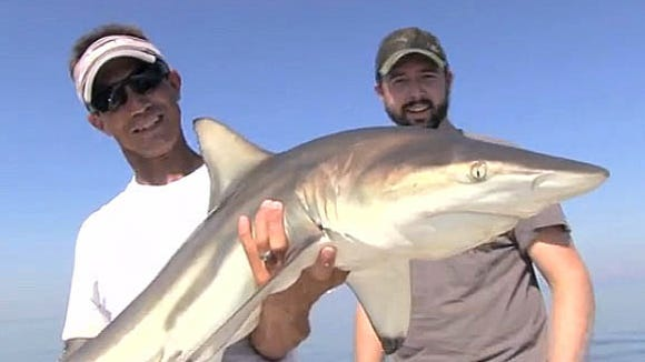 Sonny Schindler of Shore Thing Charters shows off a blacktip shark caught while filming an episode of Real South Hunting.