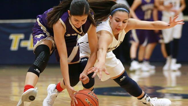Burges' Becca Cardenas, left, nad Coronado's Laura Milliorn hustle after a loose basketball during first quarter action Tuesday at Coronado.