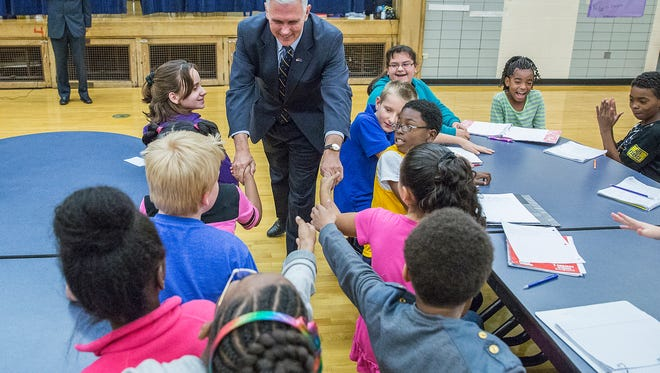 Gov. Mike Pence greets students at Longfellow Elementary School on Tuesday, Nov. 17, 2015.